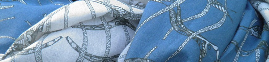 Light scarfs with unique handdrawn pattern-designs.